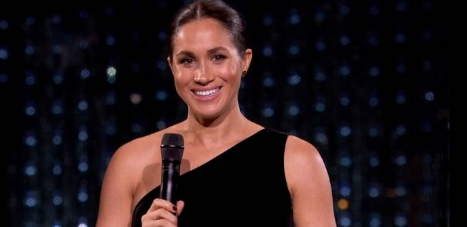The Duchess of Sussex hands out award at Fashion Awards in London